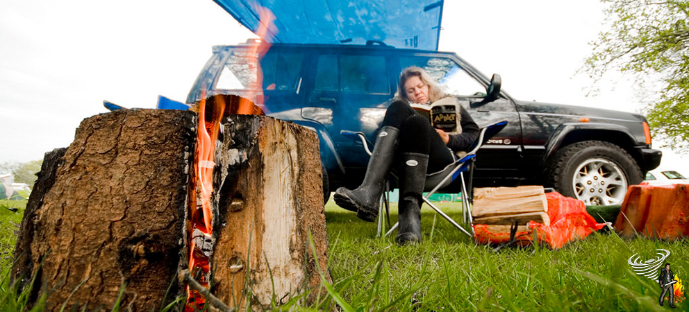 Woman sitting in from of her car survival kit